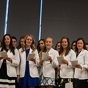Medical students in the new UW School of Medicine-GU Regional Health Partnership<br /> take part in the white coat ceremony. (Photo by Edward Bell)