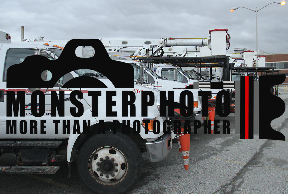 A fleet of Lewis Tree Service, Inc, truck wait in line Wednesday, Oct. 31, 2012, in Wilmington DE.  ..DPL Staging Area is an Operations Center for the Mutual Assistance Crews coming from the surrounding states to support restoration efforts.