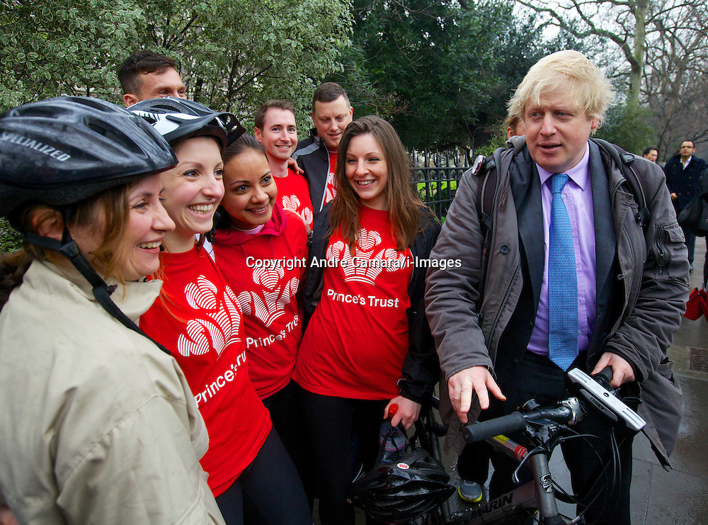 "Mayor of London Boris Johnson gets asked to pose impromptu with a group who were cycling on 'Boris bikes' all over London for charity and who came across the mayor as he was announcing he will create a ""Crossrail for the bike"" as part of his plans to invest nearly £1 billion investment in London cycling, March 7, 2013. Photo by Andre Camara / i-Images."