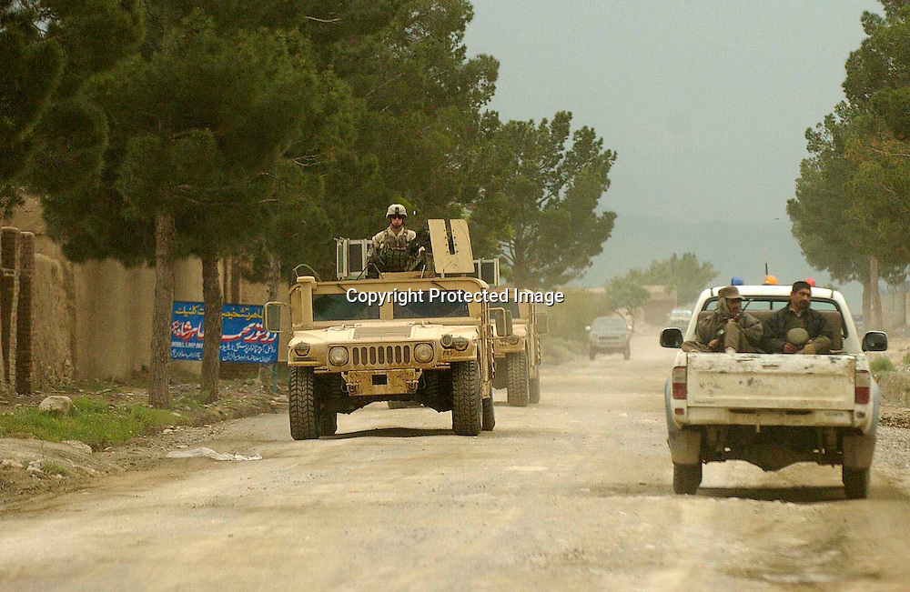 A military convoy makes its way to the Salerno base near the the town of Yakubi in the district of Khost, Afghanistan where deceased farmer Diliwar lived May 2, 2005.  The 22-year-old farmer and part-time taxi driver died in December 2002 while being held in the main United States air base at Bagram, north of Kabul. His death was ruled a homicide by the Army medical examiner.<br /> <br /> Photo by Keith Bedford