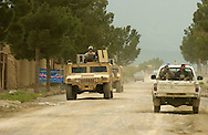 A military convoy makes its way to the Salerno base near the the town of Yakubi in the district of Khost, Afghanistan where deceased farmer Diliwar lived May 2, 2005.  The 22-year-old farmer and part-time taxi driver died in December 2002 while being held in the main United States air base at Bagram, north of Kabul. His death was ruled a homicide by the Army medical examiner.<br />