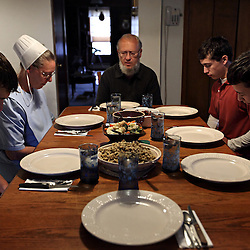 The Amish family of Jerry Schlabach prays during dinner at their home in Berlin, Ohio, Oct. 13, 2009.