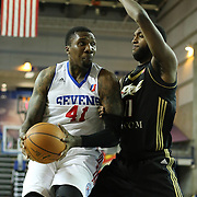 """Delaware 87ers Forward Keith """"Tiny"""" Gallon (41) drives towards the basket as Erie BayHawks Forward CJ Leslie (11) defends in the first half of a NBA D-league regular season basketball game between the Delaware 87ers (76ers) and the Erie BayHawks (Knicks) Tuesday, Feb. 11, 2014 at The Bob Carpenter Sports Convocation Center, Newark, DE"""