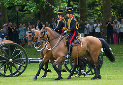 Green Park, London, June 11th 2016. Marking Her Majesty The Queen's official birthday, the Royal King's Horse Artillery fires a 41-Gun-Salute in Green Park. PICTURED: The horse drawn guns of The Royal King's Horse Artillery arrive in Green Park.