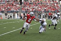 Terrelle Pryor stiff arms a defender in the Ohio State vs Penn State game on Nov. 13, 2010 at Ohio Stadium in Columbus, Ohio.