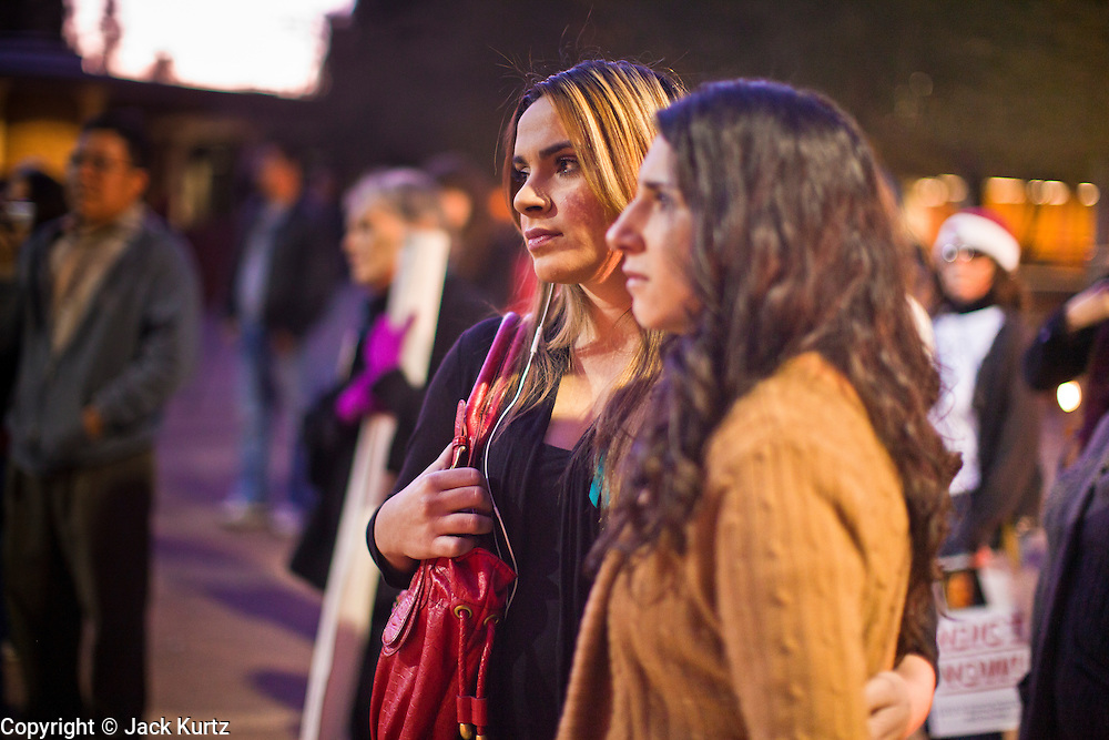 22 DECEMBER 2011 - PHOENIX, AZ:   Women at a vigil against sexual violence in Phoenix. About 300 people marched through downtown Phoenix Thursday night in a silent candle lit procession to protest against the way the Maricopa County Sheriff's Department, led by Sheriff Joe Arpaio, has conducted sexual assault and rape investigations. Two recent media reports, one by the East Valley Tribune, a newspaper in Mesa, AZ, and one by the Associated Press, concluded that the Sheriff's department has bungled more than 430 rape investigations. Last week, a US Department of Justice report cited the unresolved rape investigations along with evidence of wide spread racial profiling by the sheriff's department in a report that was highly critical of Sheriff Arpaio and the Sheriff's Department.   PHOTO BY JACK KURTZ