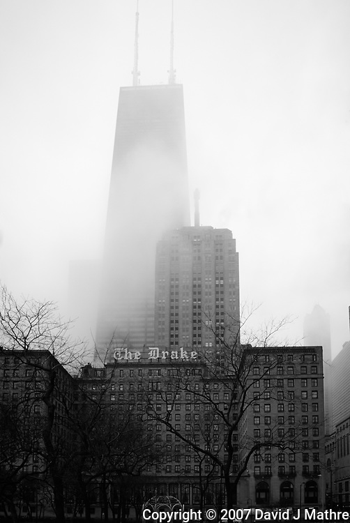 The Drake and John Hancock Tower in the Fog. Spring in Chicago. Image taken with a Nikon D200 and 18-200 mm VR lens (ISO 400, 18 mm, f/7.1, 1/200 sec). Raw image processed with Capture One Pro 7.