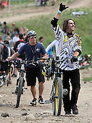 SHOT 7/29/11 4:12:08 PM - Cam McCaul (right) acknowledges the cheersof fans after his run during slopestyle qualifiers at Crankworx Colorado at the Trestle Bike Park in Winter Park, Co. McCaul won the event with a score of 93.00. The event is a Pro-am mountain bike competition featuring a dual slalom race, the Trestle Unchained Challenge, slopestyle and cross country racing events where top pros competed for more than $35,000 in prize money. (Photo by Marc Piscotty / © 2011)