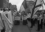 Episcopal Ordination Of Desmond Connell. (R74).1988..06.03.1988..03.06.1988..6th March 1988..Following the death of Archbishop Kevin McNamara in April '87, Pope John Paul II surprisingly nominated Desmond Connell for the position of Archbishop of Dublin. The ordination of Dr Connell took place at the Pro-Cathedral in Dublin...Cardinal Tomás O'Fiach, in happy mood, is pictured grasping the Tricolour as he passes the scouts in the guard of honour.