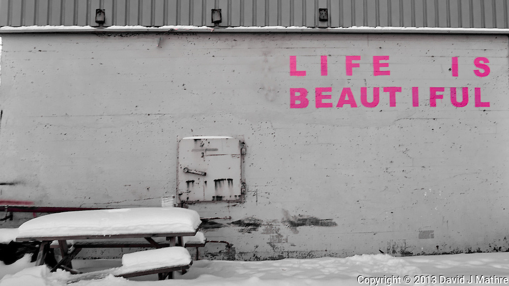 """""""Life is Beautiful"""" painted in pink on a wall in Tromsø, Norway. Image taken with a Leica X2 camera (ISO 100, 24 mm, f/5, 1/50 sec). Raw image processed with Capture One Pro"""