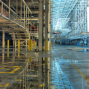 Morning sun reflection at body drop line, where automobile chassis and body joined, screen guard for chassis return line on the left, Chrysler Newark assembly plant, HDR image