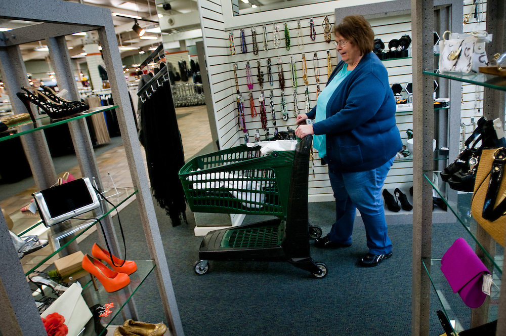 Linda Mckee from Huntsville, AL comes to shop at the Unclaimed Baggage Center once a month. This time she came to get a cell phone charger that would've cost her $30 at the cell phone store. She found it here for $2.06. She also ended up buying a jacket and pants among other things...The Unclaimed Baggage Center is a retail store located in Scottsboro in Jackson County, Alabama. The store's concept is the reselling of lost or unclaimed airline luggage. Over a million customers visit the 50,000-square-foot (4,600 m2) store each year to browse through some of the 7,000 items added each day.