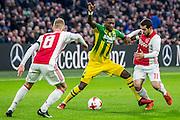 AMSTERDAM - Ajax - ADO , Voetbal , Eredivisie , Seizoen 2016/2017 , Amsterdam ArenA , 29-01-2017 ,  ADO Den Haag speler Sheraldo Becker (m) in duel met Ajax speler Amin Younes r en Ajax speler Daley Sinkgraven (l)