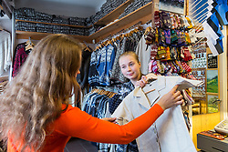 Women in Eva handicraft shop in Tartu. Flaxen jacket, shirt.