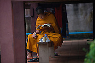 A monk studies at on the grounds of Wat Sisaket