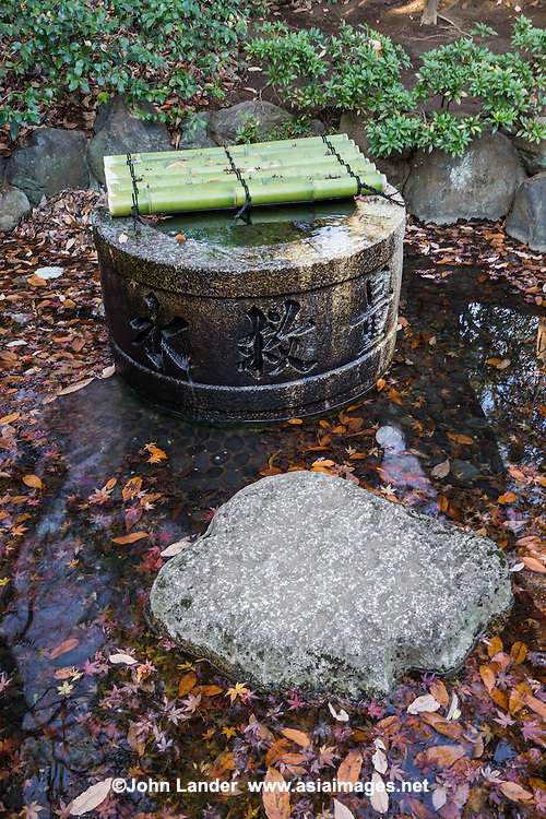 Mizubachi or chozubachi is a water basin.  This one was constructed mainly for washing and drinking water, though most chozubachi are found at temples for the sake of purifying the hands and mouth.  A similar object is the tsukubai though it should be noted that these are found chiefly at tea ceremony huts or Japanese gardens devoted to tea ceremony.  This particular mizubachi was brought to Chinzanso Garden from Kyoto.