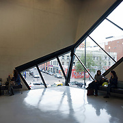 Young lunchtime women in the Daniel Libeskind designed Graduate Centre at London Metropolitan University's Holloway Road campus