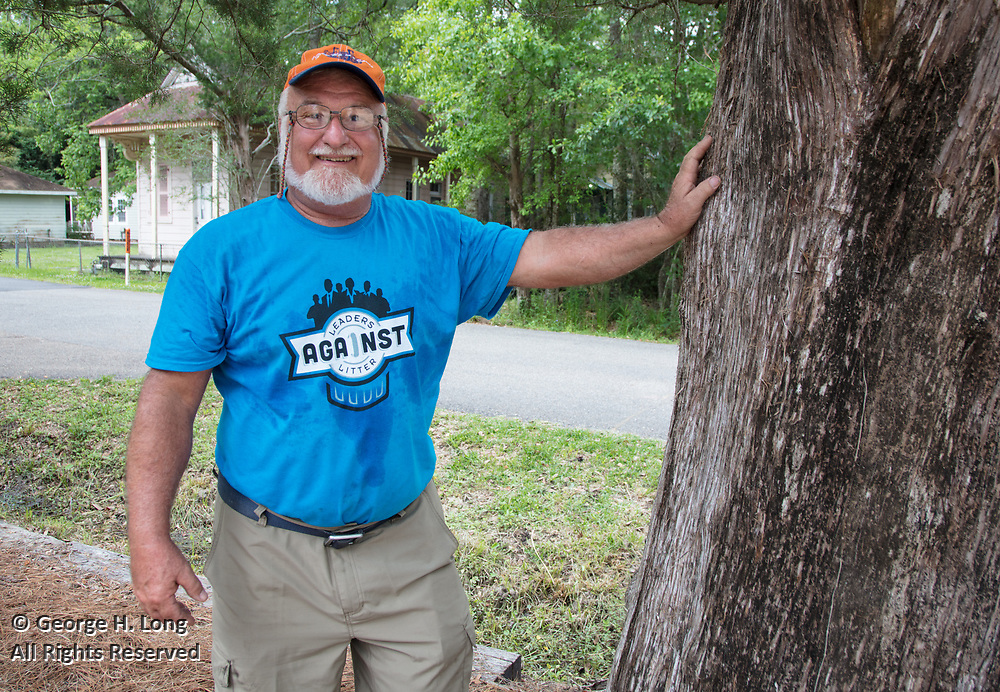 Adrian Juttner inspects a tree for insect damage during the Trash Bash sponsored by Keep Abita Beautiful in Abita Springs, Louisiana