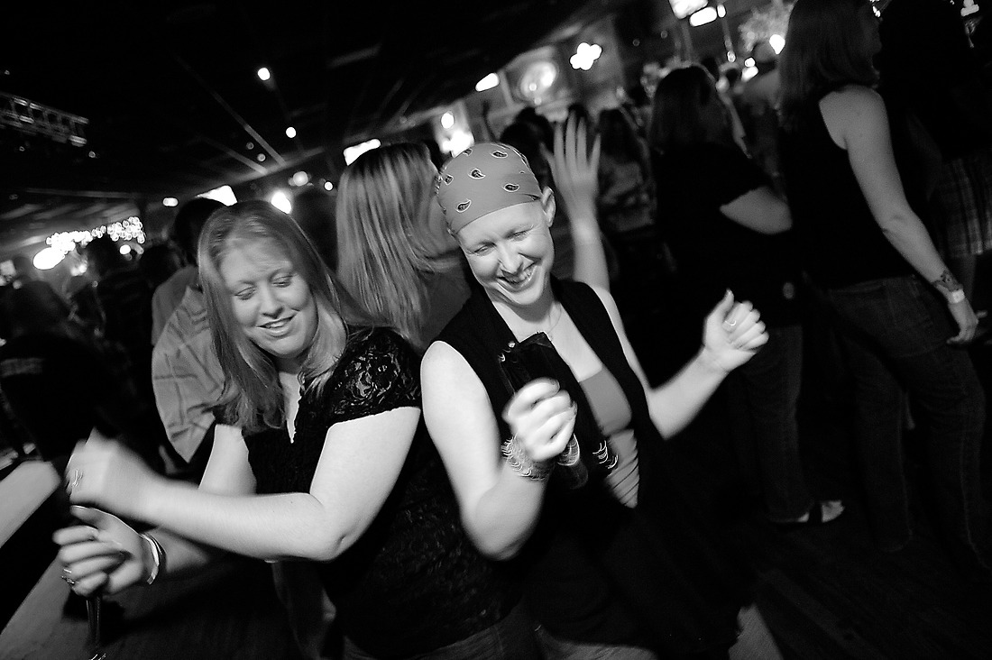 Keri laughs and dances with her twin sister Teri and friend/roommate  Chrissy Best while enjoying a night out at a bar in North Charleston, South Carolina. — © /