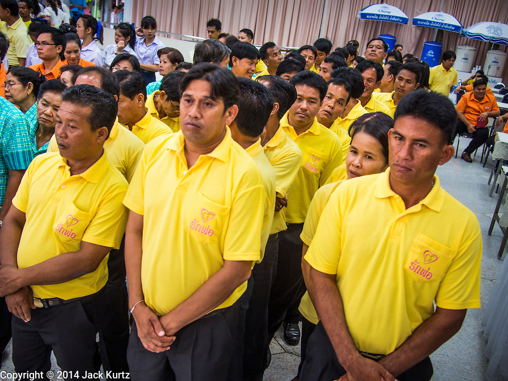 28 NOVEMBER 2014 - BANGKOK, THAILAND: Thais wait to offer birthday and get well wishes for Bhumibol Adulyadej, the King of Thailand. The King was born on December 5, 1927, in Cambridge, Massachusetts. The family was in the United States because his father, Prince Mahidol, was studying Public Health at Harvard University. He has reigned since 1946 and is the world's currently reigning longest serving monarch and the longest serving monarch in Thai history. Bhumibol, who is in poor health, is revered by the Thai people. His birthday is a national holiday and is also celebrated as Father's Day. He is currently hospitalized in Siriraj Hospital, recovering from a series of health setbacks. Thousands of people come to the hospital every day to sign get well cards for the King. People wear yellow at events associated with the King because he was born on a Monday, and yellow is Monday's color in Thai culture. It's also the color of the monarchy.       PHOTO BY JACK KURTZ