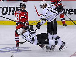 June 9, 2012; Newark, NJ, USA;  New Jersey Devils right wing Dainius Zubrus (8), Los Angeles Kings center Anze Kopitar (11) and Los Angeles Kings right wing Justin Williams (14) collide during the first period of Game 5 of the 2012 Stanley Cup Finals at the Prudential Center.