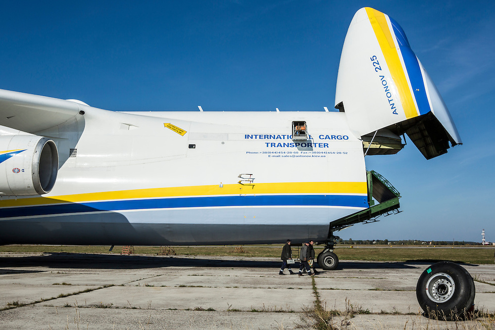 GOSTOMEL, UKRAINE - OCTOBER 1, 2014: Maintenance workers walk near the Antonov AN-225, the longest and heaviest airplane ever built, on an airfield in Gostomel, outside Kiev, Ukraine. CREDIT: Brendan Hoffman for The New York Times
