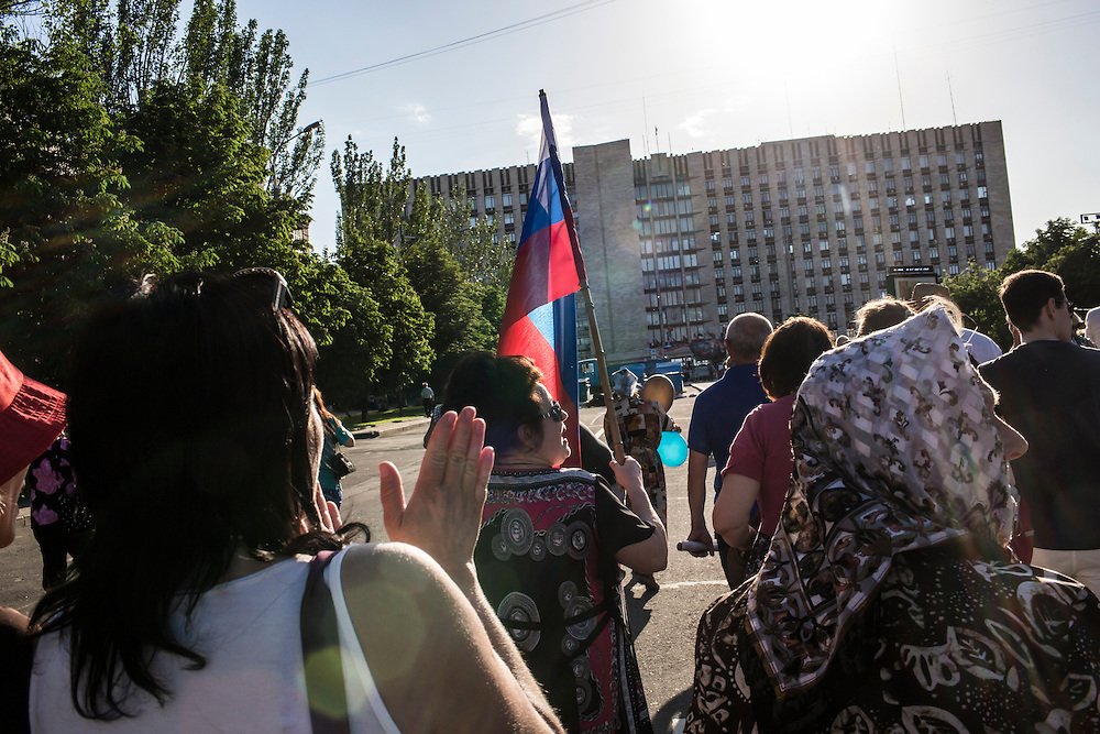 DONETSK, UKRAINE - MAY 24: Pro-Russian demonstrators march to the regional administration building, headquarters of the Donetsk separatist movement, on May 24, 2014 in Donetsk, Ukraine. With presidential elections scheduled tomorrow, tensions in Eastern Ukraine are high with separatist groups working to prevent the election from taking place. (Photo by Brendan Hoffman/Getty Images) *** Local Caption ***
