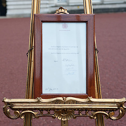 London, UK - 23 July 2013: An easel stands in the Forecourt of Buckingham Palace in London to announce the birth of a baby boy, at 4.24pm of the 22nd of July to the Duke and Duchess of Cambridge at St Mary's Hospital
