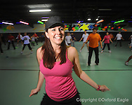 Caysie Lagrone teaches a Zumba class at the Skate Place in Oxford, Miss. on Wednesday, February 18, 2010.