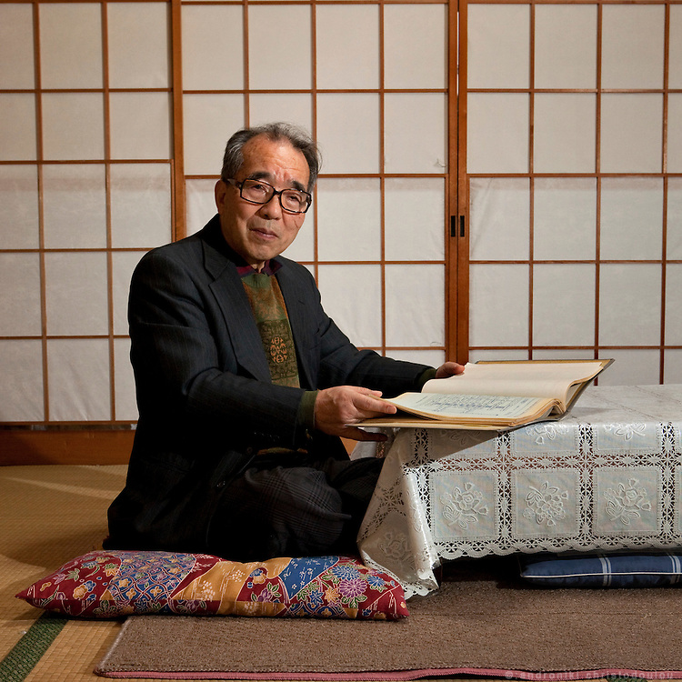 Kondo-san, an automobile engineer that has worked for a Chinese company for 10 years after his reitrement, in his house in Nagano.<br /> Kondo-san in the living-room of his traditional Japanese house, with documents related to his work.