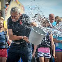 Cllr Kevin Murphy gets a refreshing shower at the Kinsale Regatta.