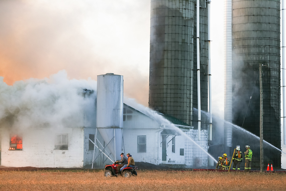 Firefighters battle a barn fire near St. Thomas, Ont. Monday,  February 1, 2016. About 100 cattle were in the dairy barn when it went up in flames. Only a handful escaped.<br /> Farmers Forum/ Geoff Robins