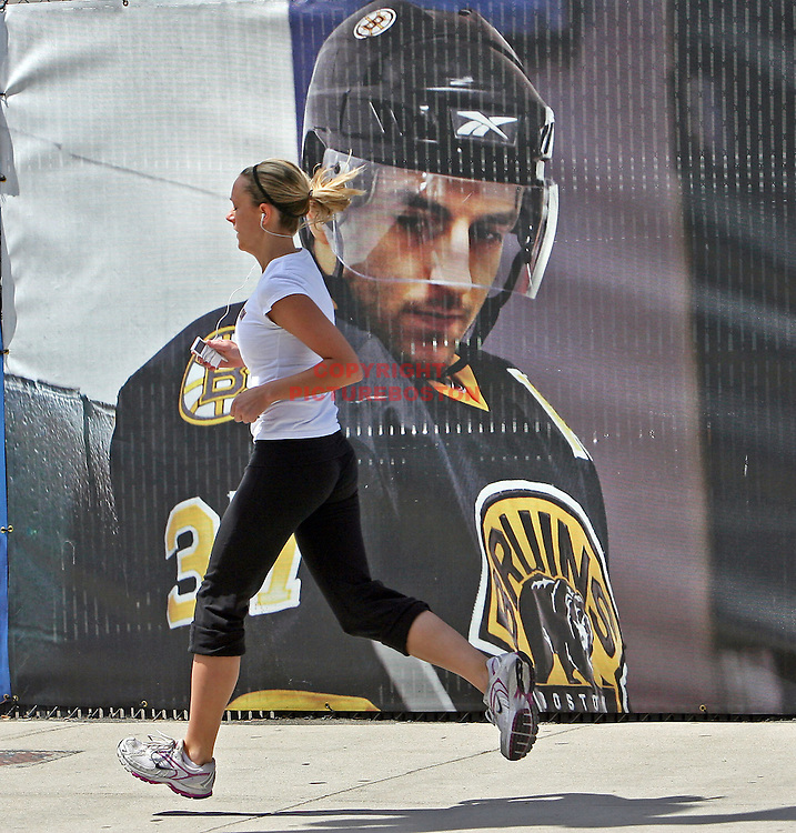 Bruins playoff excitement builds on Causeway Street. Large posters of Bruins' players adorne the border fence at TD Garden.