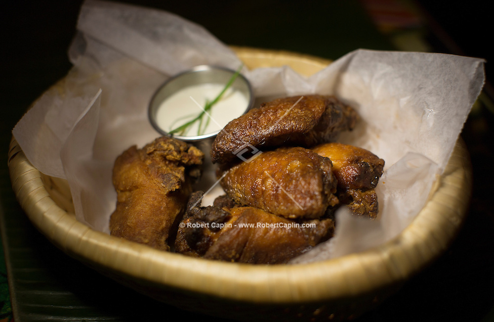 Adobo wings at Jeepney, a Filipino restaurant in New York...Photo by Robert Caplin..