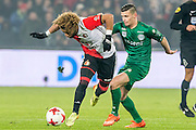 ROTTERDAM - Feyenoord - FC Groningen , Voetbal , Eredivisie , Seizoen 2016/2017 , Feijenoord stadion de Kuip , 11-02-2017 ,  FC Groningen speler Bryan Linssen (r) in duel met Feyenoord speler Tonny Vilhena (l)