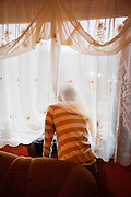 Milan Dano (17) looks out of the window of his father's flat in Presov, Slovakia.
