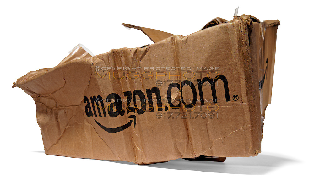 Damaged Destroyed Amazon package on white background