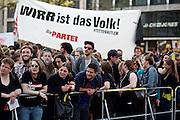 Frankfurt am Main   21 Apr 2015<br /> <br /> Am Dienstag (21.04.2015) hielt die rassistische und islamfeindliche Gruppe PEGIDA (Patriotische Europ&auml;er gegen die Islamisierung des Abendlandes) an der Hauotwache neben der Katharinenkirche in Frankfurt am Main eine Mahnwache unter dem Motto &quot;Wir sind wieder da&quot; ab. Die Kundgebung war wie immer mit Hamburger Gittern abgesperrt und von starken Polizeikr&auml;ften bewacht. Etwa 1000 Menschen nahmen an den Gegenprotesten teil.<br /> Hier: Gegenproteste mit einem Transparent der Partei &quot;Die Partei&quot; mit der Aufschrift &quot;Wirr ist das Volk&quot;.<br /> <br /> &copy;peter-juelich.com<br /> <br /> [Foto Honorarpflichtig   No Model Release   No Property Release]