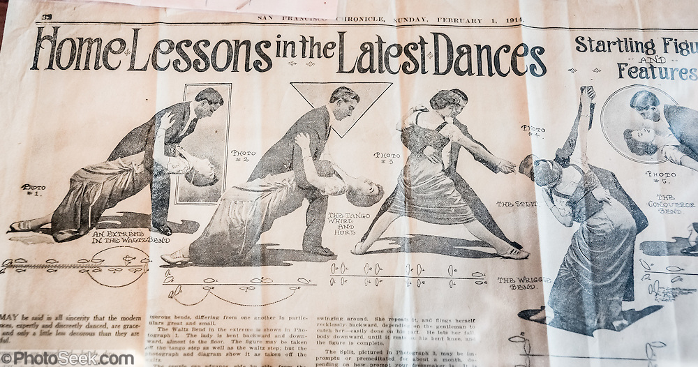 """During the decline of the gold mining town Bodie, a newspaper article illustrates """"Home Lessons in the Latest Dances"""" with a couple doing an extreme waltz bend, tango whirl & twirl, split, and wriggle bend (from the San Francisco Chronicle, February 1, 1914). At the Bodie Museum and Visitor Center, view this and many other curious artifacts of bygone eras. Bodie is California's official state gold rush ghost town. Bodie State Historic Park lies in the Bodie Hills east of the Sierra Nevada mountain range in Mono County, near Bridgeport, California, USA. After W. S. Bodey's original gold discovery in 1859, profitable gold ore discoveries in 1876 and 1878 transformed """"Bodie"""" from an isolated mining camp to a Wild West boomtown. By 1879, Bodie had a population of 5000-7000 people with 2000 buildings. At its peak, 65 saloons lined Main Street, which was a mile long. Bodie declined rapidly 1912-1917 and the last mine closed in 1942. Bodie became a National Historic Landmark in 1961 and Bodie State Historic Park in 1962."""