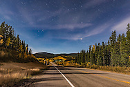 Playing with stacking star trails in a scene loking down Highway 66 toward the Elbow River bridge in Kananaskis Country, Alberta, with apens in full fall foliage. Moonlight provides the illumination. <br /> <br /> This is a stack of 5 exposures, with 4 mean combined to smooth noise and the 5th added in with a Lighten blend mode to add the brighter stars at the start of the trails. All were 30 seconds at f/5.6 with the 24mm lens and Nikon D750 at ISO 1250.