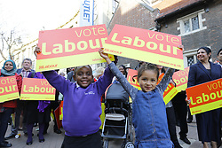 © Licensed to London News Pictures. 19/04/17. Croydon, UK.  Young supporters hold up pro-labour signs before Labour Party leader JEREMY CORBYN addresses supporters in Croydon town centre, joined by labour councillors and supporters, on the day that the House of Commons voted for a asap general election on June 8, 2017.  Photo credit: Grant Melton/LNP