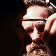 Hairstylist Jeffrey Moffett from Pileggi studio's cutting model Sarah hair during Scissor Candy open chair 12 Sunday, Apr. 27, 2014 at National Mechanic in Philadelphia Pennsylvania.