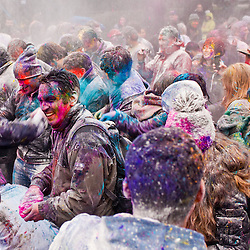 London, UK - 23 March 2013: people play with powder during the Holi Spring Festival of Colour takes place at Orleans House Gallery in Twickenham. The annual event marks the end of Winter and welcomes the joy of spring.