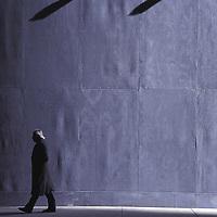 Misterious lonely man with white hair walking &amp;#xA;Rockefeller Plaza&amp;#xA;New York City&amp;#xA;&copy; KIKE CALVO - V&amp;W<br />