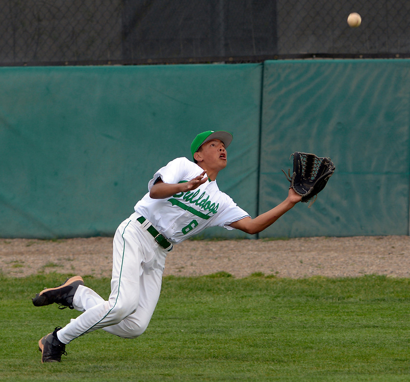 gbs041117o/SPORTS -- Albuquerque High right fielder Javier Pavia, 6, dives but misses the ball hit by Atrisco Heritage's Steven Barboa allowing a double in the third inning of the game at Albuquerque High on Tuesday, April 11, 2017.(Greg Sorber/Albuquerque Journal)