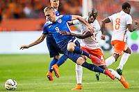 AMSTERDAM - Nederland - USA , Amsterdam ArenA , Voetbal , oefeninterland , 05-06-2015 , Nederlands elftal speler Bruno Martins Indi (r) zet Nederlands elftal speler Klaas Jan Huntelaar (l) opzij