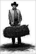 Sen. Jim Isgar, D-Hesperus, is probably the last true rancher to serve in a legislature that was once controlled by the ?Cowboy Caucus.? He owns Isgar Ranches with 125 head of cattle and sells hay and grass for feeding. He is holding an 80 pound bale of grass hay. He said he used to have more cattle but was forced to sell off a large number during the drought a few years back..(Photo by MARC PISCOTTY / ©2006) CQ Sen. Jim Isgar
