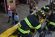 Probationary Fire fighters and veterans AJ Maresca, center, Kamil Mizinski, right, and Victor Ramos, back right, back up the hose at the 16th Street Fire House of the North Hudson Regional Fire and Rescue in Union City, NJ on November 07, 2013. Many vets say after the military they're still looking for a career with a sense of public service. Some vets have found that at the North Hudson Regional Fire and Rescue in New Jersey.