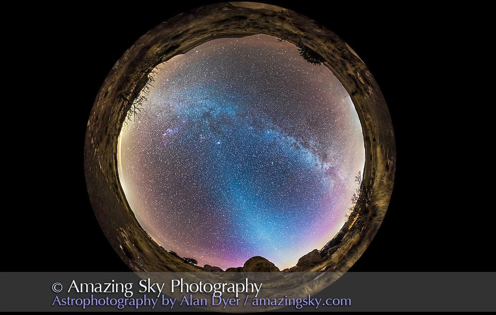 A 360° fish-eye panorama of the evening sky, January 16, 2015, showing the Zodiacal Light rising out of the western sky and last vestiges of twilight, and the Milky Way across the sky in the east. Comet Lovejoy (C/2-14 Q2) near the Pleiades just left of centre at the top of the pyramid of light from the Zodiacal Light. A meteor appears below centre. This is a stitch of 8 segments, each taken with the 15mm lens and Canon 6D in portrait orientation, for 1 minute at ISO 3200 and f/2.8. Stitched with PTGui.