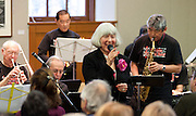 Vocalist Jo Peterson performs with the Minidoka Swing Band in the US Bank Room of Multnomah County Library - Central branch, Portland, Oregon. The performance was in conjunction with Portland Center Stage's production of Snow Falling on Cedars, by David Guterson.